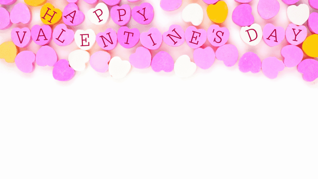 valentine theme white background with pink, white and yellow candy hearts that say happy valentines day free virtual zoom background image